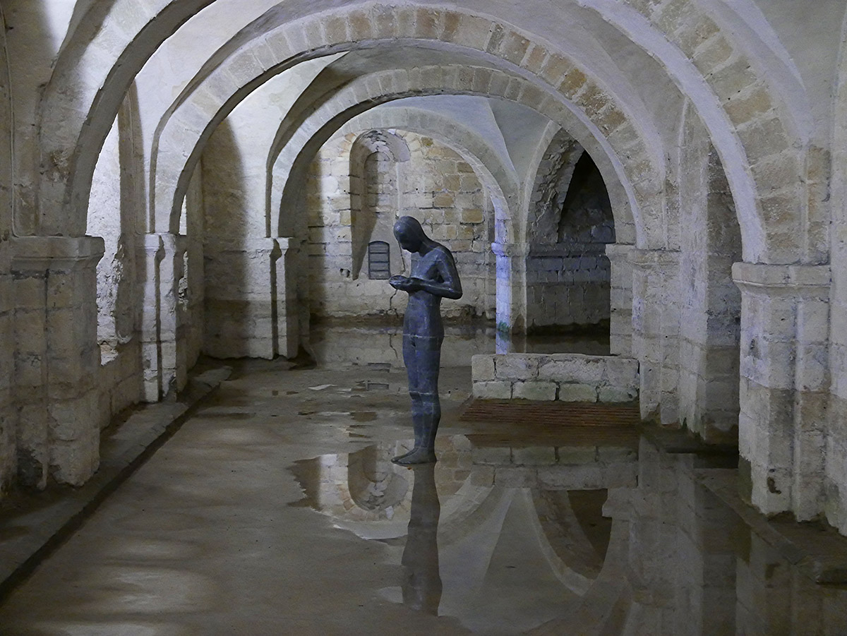 "Antony Gormley's ""Sound II"" in the Norman crypt of Winchester Cathedral"