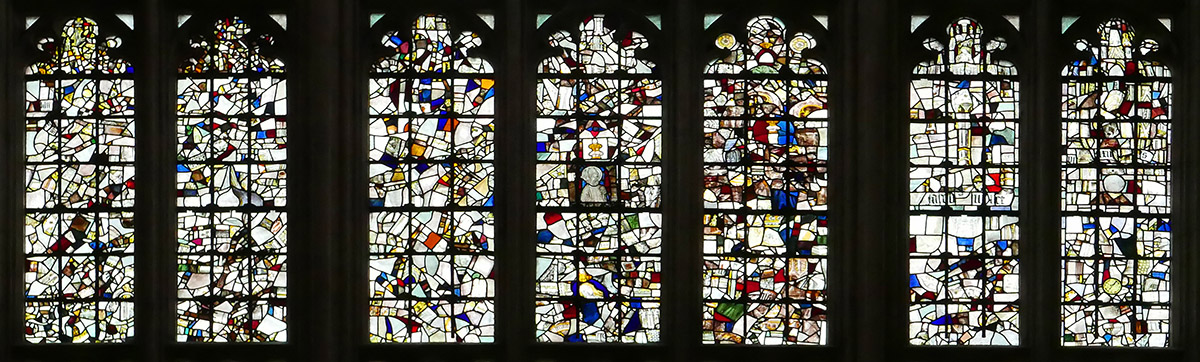 A mid-section of the Great West Window of Winchester Cathedral - the original mediaeval windows were destroyed by Oliver Cromwell's troops at the beginning of the First English Civil War in 1642. Fragments were collected and reassembled in this near random order after the Restoration in 1660.
